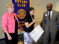 Pictured: l-r Rotary Club of Sandy Springs members Fran Farias, Tamara Carrera (Executive Director, CAC), Cory Jackson